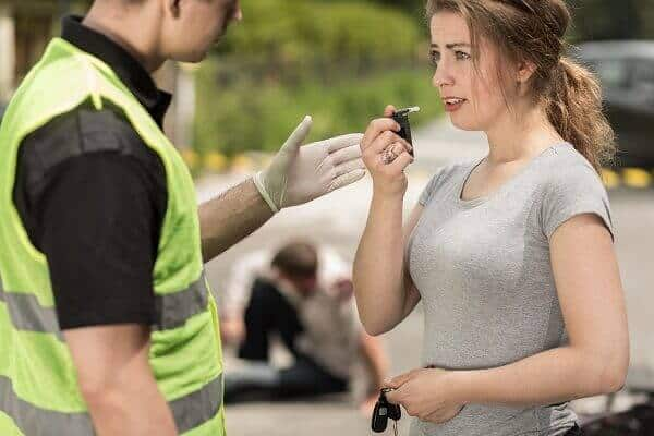 Police Administering a Breathalyzer Test